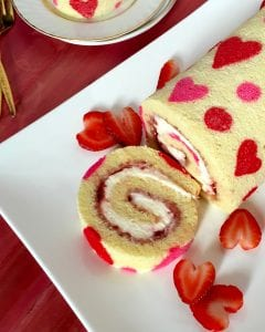 I Heart Cake Roll with fresh strawberry hearts