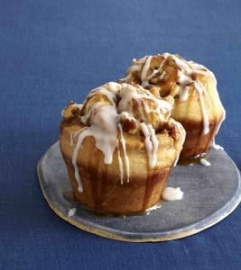 Two Sticky Buns with white icing on platter