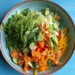 Sesame Ginger Dressing with Asian Salad ingredients in bowl