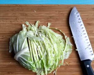 Chopped cabbage with knife step recipe image