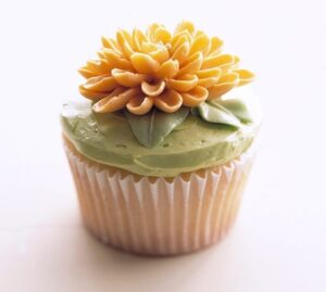 Vanilla cupcakes with Mum flower made from frosting