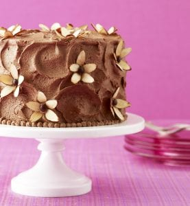 Almond Flower Cake with milk chocolate frosting and almond flowers