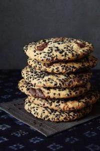 Black Sesame Cookies Stacked on black linen napkin
