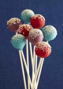 Multi colored cake pops on white sticks