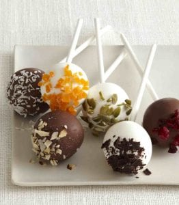Vanilla and chocolate covered cake pops on white platter