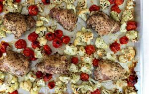 Roasted Chicken, cherry tomatoes and Cauliflower in pan