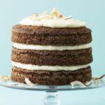 Ginger Coconut Carrot Cake on glass cake pedestal