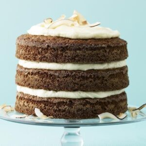 Ginger Coconut Carrot Cake on glass cake pedestal