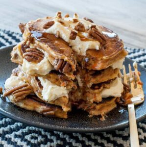 Carrot cake pancakes with cream cheese frosting and pecans