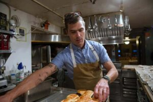 Hugh Acheson making blended burgers - James Beard Foundation winner
