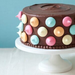 Polka Dot Cake with chocolate frosting and meringue kisses
