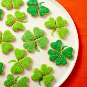 Bite sized Irish Heart Shamrock Cookies in white plate