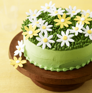 spring daisy cake on a platter