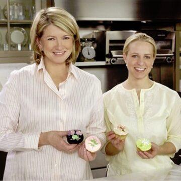 Martha Stewart and Tara Bench holding cupcakes in a kitchen