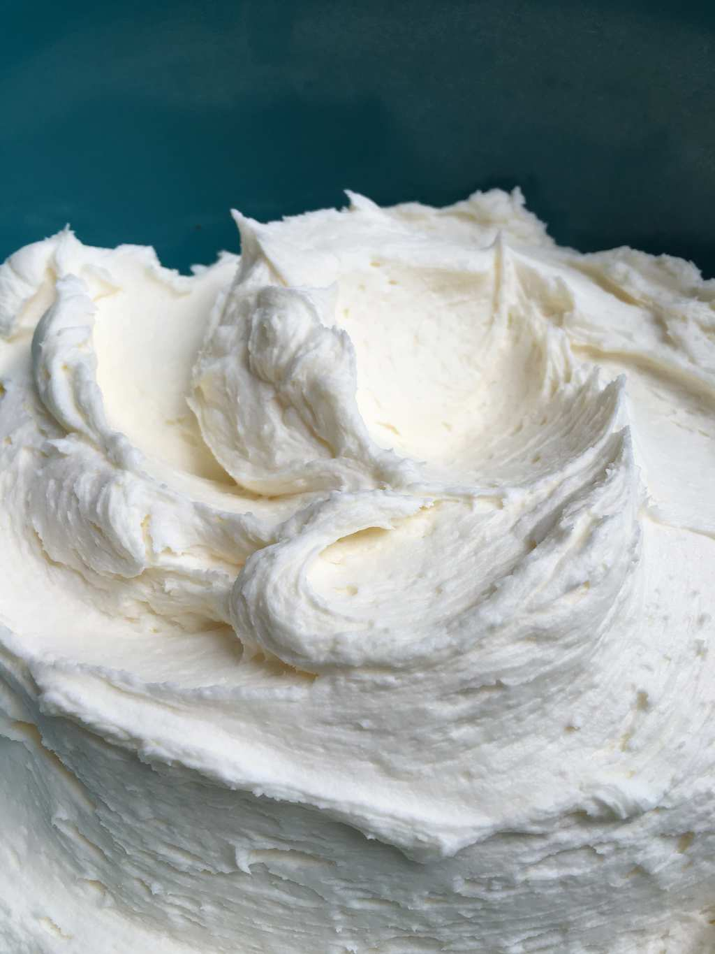 Fluffy vanilla frosting is a basic confectioners' sugar frosting that works for spreading, piping, decorating and delicious eating!