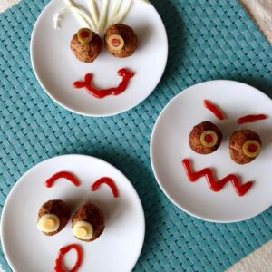 funny face meatball snacks on white plates