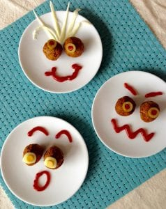 Three versions of meatball faces on white plates for Farmrich sponsored post