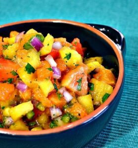 island fruit salsa in a bowl with pineapple and red onions