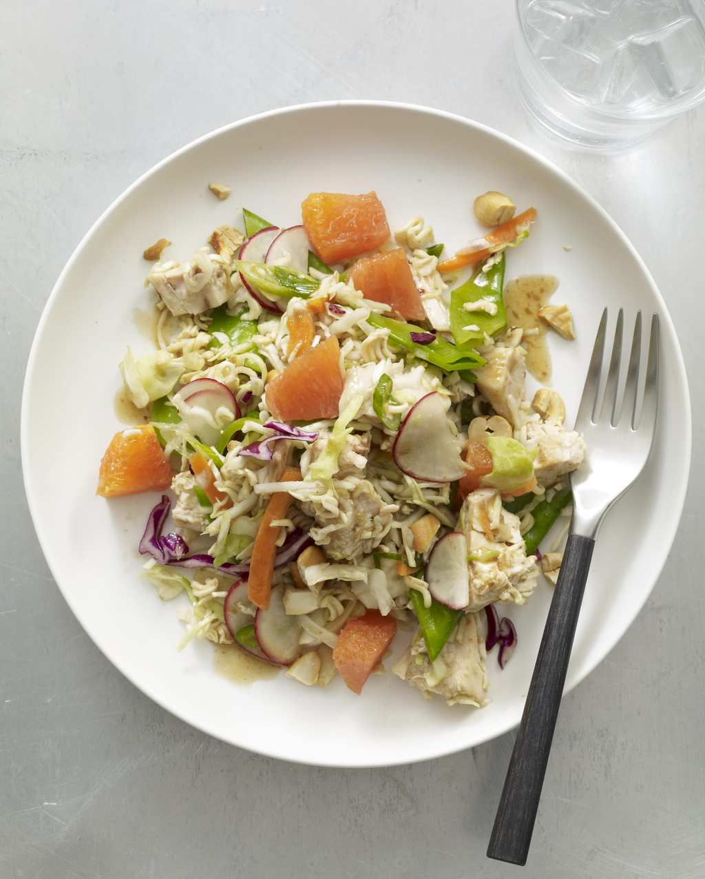 Crunchy Chicken Noodle Salad in white bowl with fork