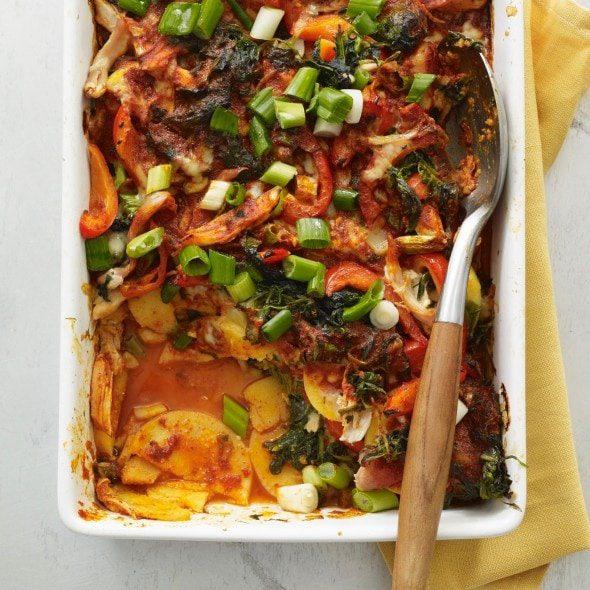Chicken enchilada bake with polenta in white baking dish
