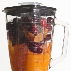 Fruit and vegetables in blender before mixing.