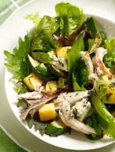 Polenta Salad with chicken in white bowl
