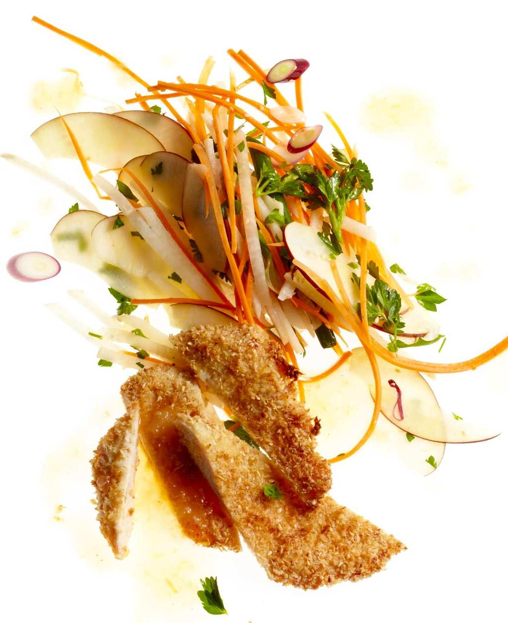 Sesame Chicken with Apple Carrot Slaw on lighted background