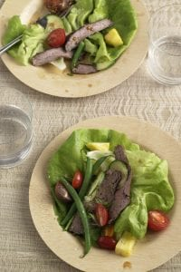 Two plates of Marinated Thai Beef Salad