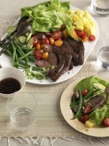Marinated Thai Beef Salad on platter and served on bamboo dinner plate