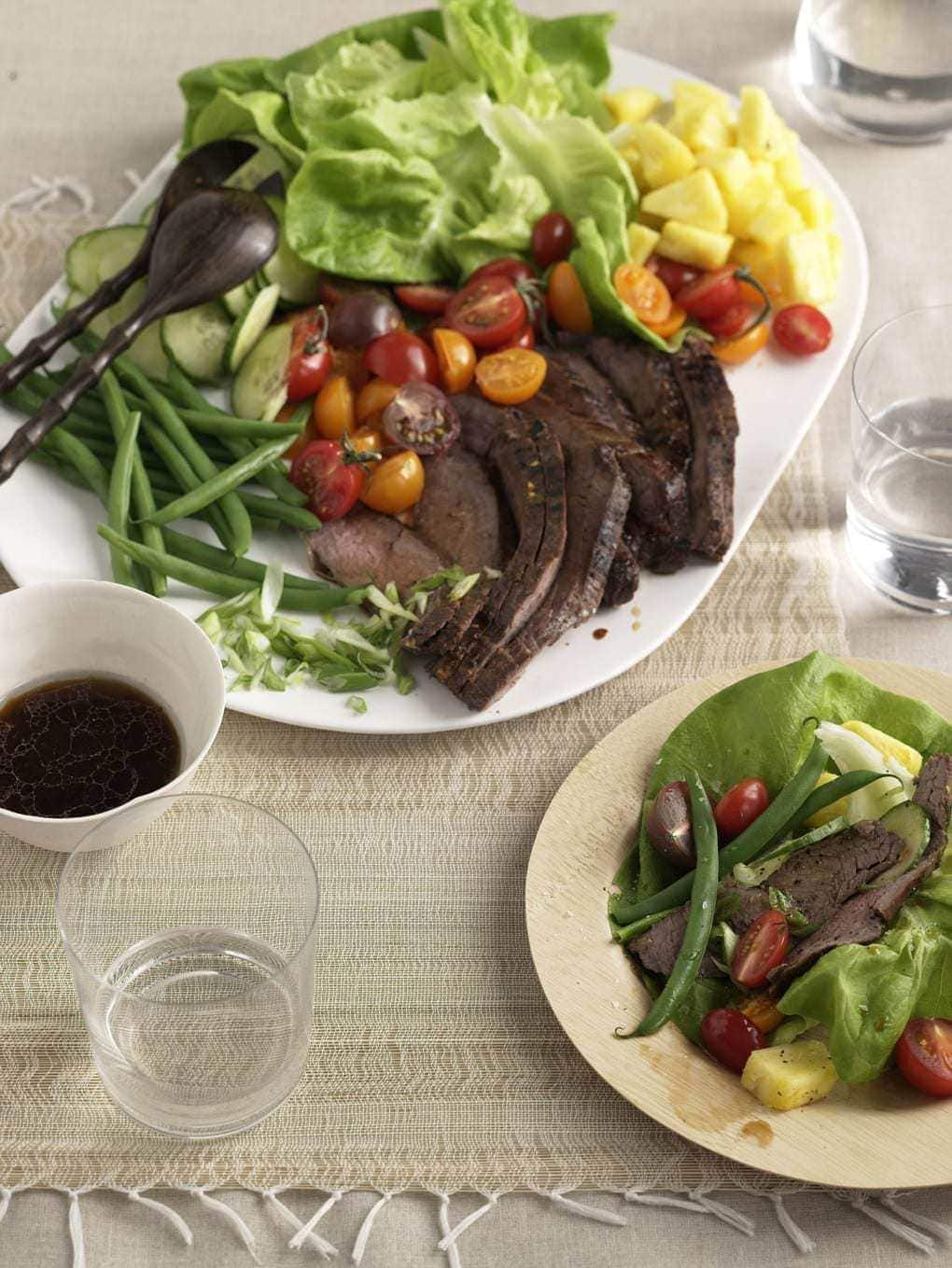 Marinated Thai Beef Salad gets a burst of flavor from authentic Thai flavors, sweet fruit and crunchy veggies. A summer dinner everyone will love.