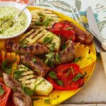 sausage and peppers with pineapple and avocado recipe image
