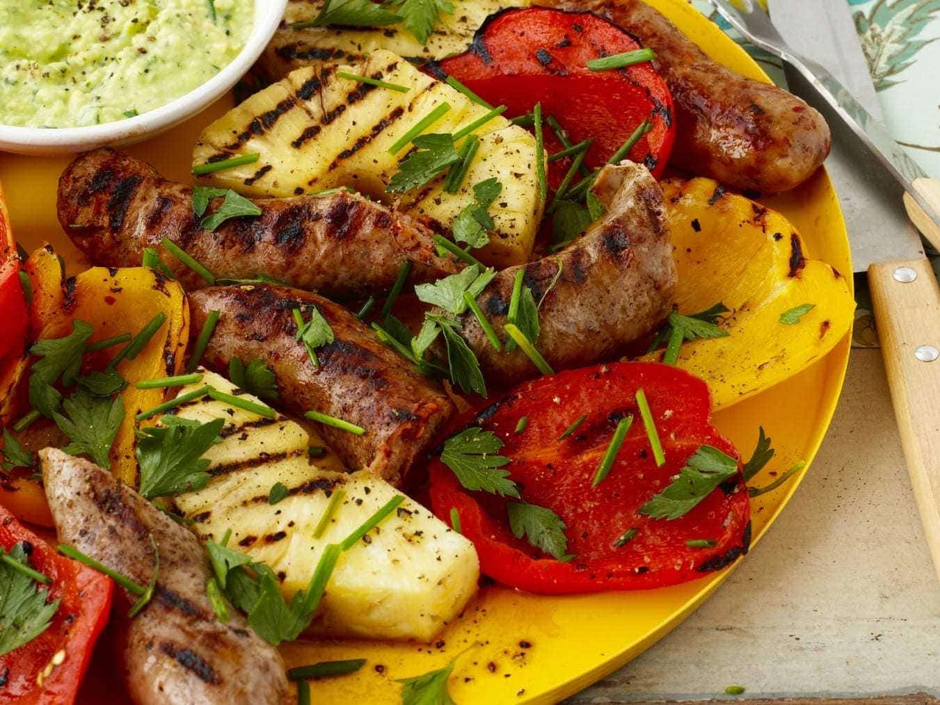 Sausage and peppers with pineapple and avocado cream