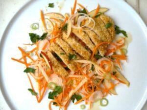 Sesame Chicken with Apple Carrot Slaw on white plate