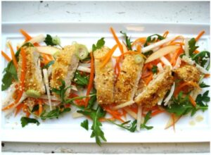 Sesame Chicken with Apple Carrot Slaw on white plate