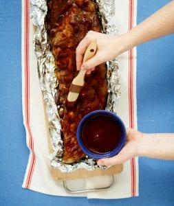 Overhead image of Tara Teaspoon saucing 3 ingredient ribs