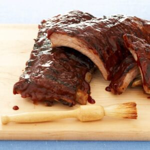 Classic ribs, a summertime staple. Tenderize these 3 ingredient, lip-smacking ribs in the oven, then grill them to perfection.