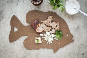 Epicurean Camp Series fish cutting board with fish, bread and cheese