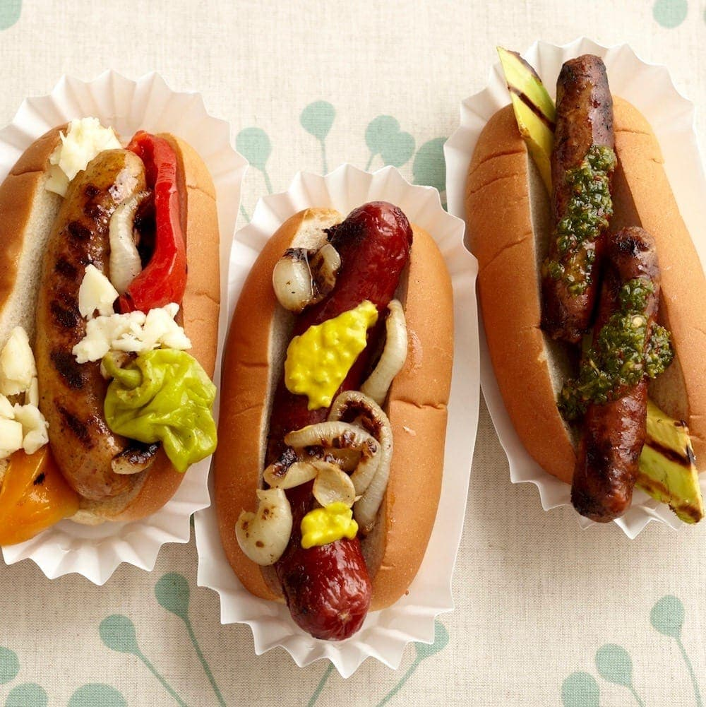 Forget the plain old hot dog. Outrageously delicious toppings, fancy hot dogs and sausages are taking summer by storm. Come up with your own combos!