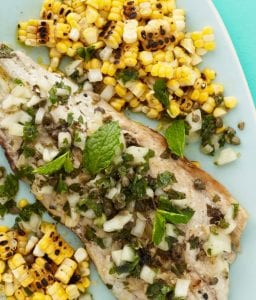 Close up of Grilled fish with capers and corn