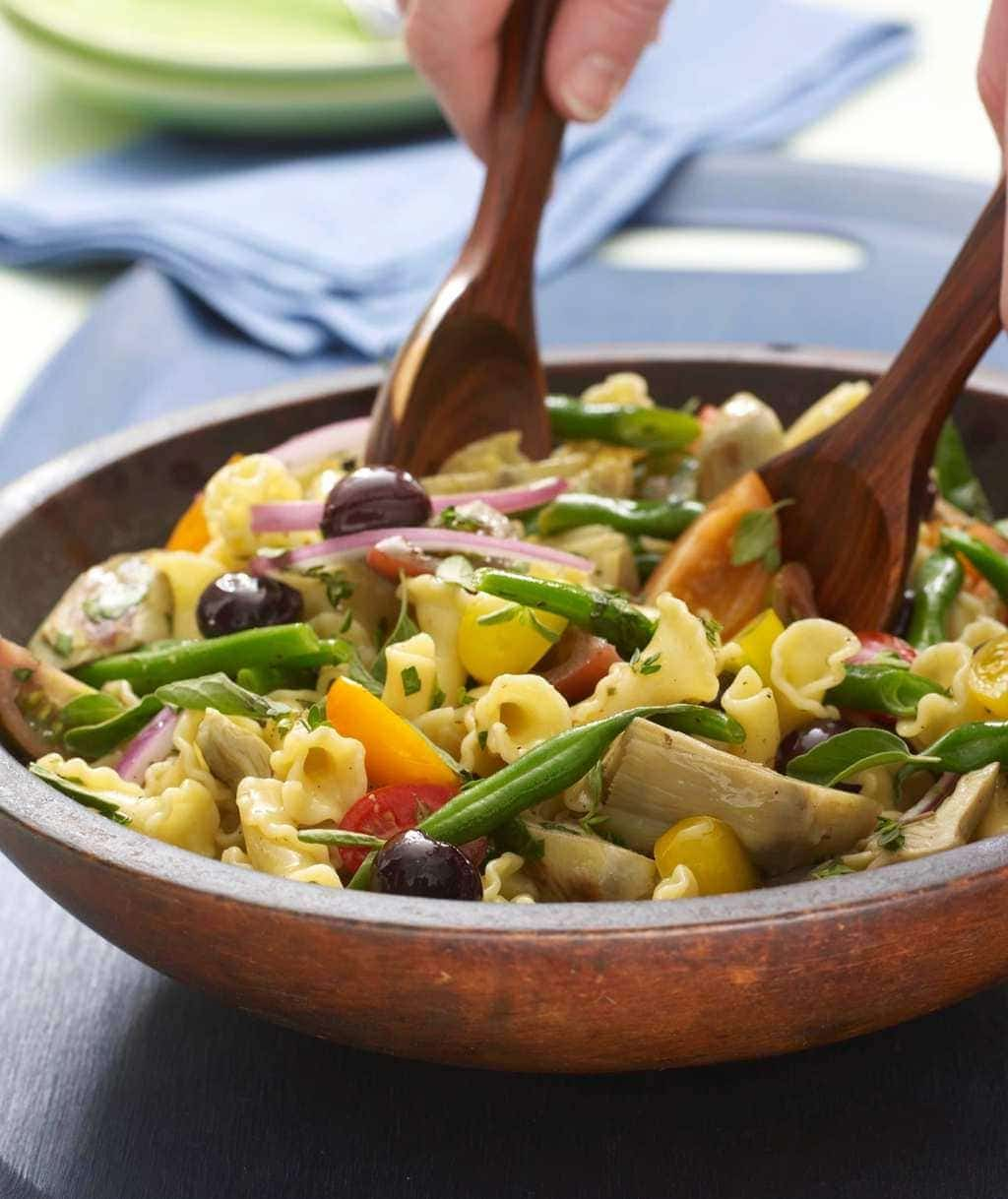 Herbed Vegetable Pasta with Artichokes in a wood bowl