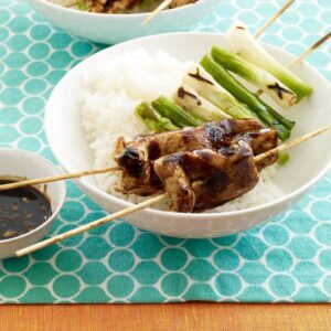 Close up of Teriyaki Chicken and Scallion Kabobs in white bowl