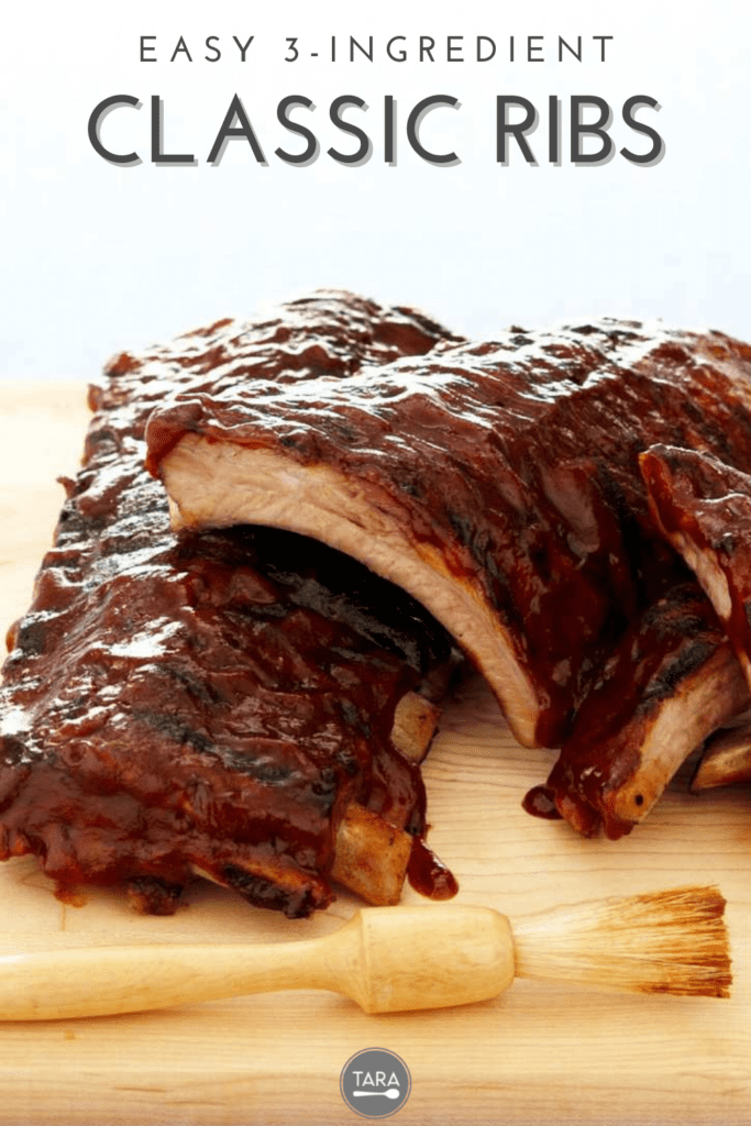 Ribs stacked on cutting board and brush