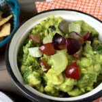Summer Grape Guacamole in bowl on table