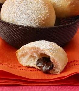 Close up of Chocolate filled rolls on orange linen napkin