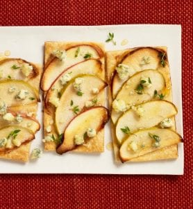 Close up of Easy apple and blue cheese tarts on white platter