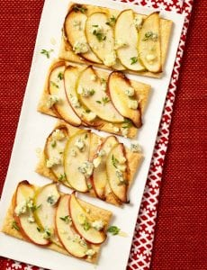 Easy apple and blue cheese tarts on white platter