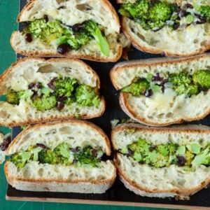 Close of Roasted broccoli melt slices on tray