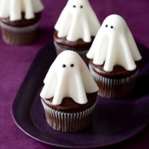 Floating ghost cupcakes on small dark plate