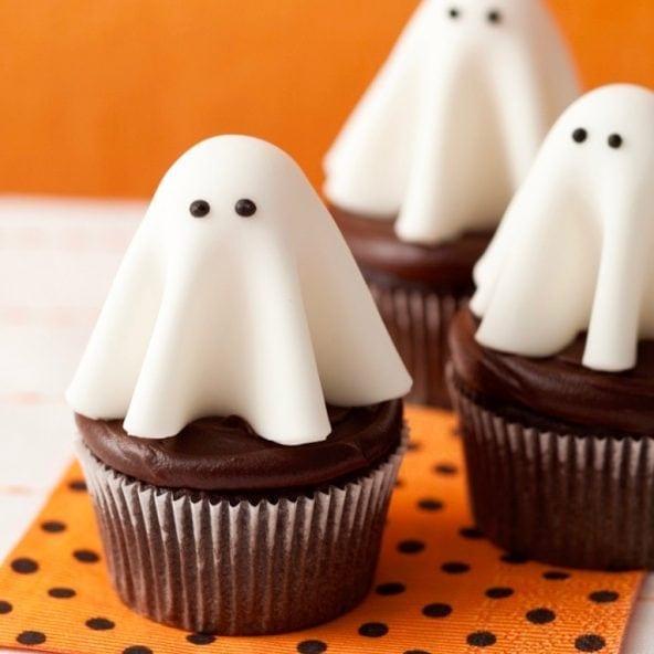 Floating ghost cupcakes on orange and black polka dot napkin