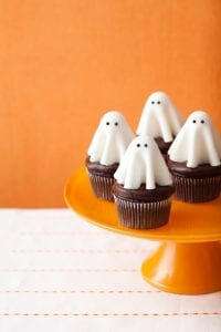 Floating ghost cupcakes on orange cake stand